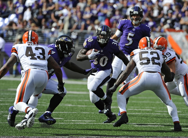 Sep 15, 2013; Baltimore, MD, USA; Baltimore Ravens running back Bernard Pierce (30) runs with the ball against the Cleveland Browns during the second half at M&T Bank Stadium. The Ravens won 14 - 6. Mandatory Credit: Brad Mills-USA TODAY Sports