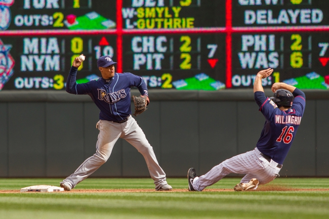 Sep 15, 2013; Minneapolis, MN, USA; The Tampa Bay Rays shortstop Yunel Escobar (11) turns the double play in the sixth inning against Minnesota Twins left fielder Josh Willingham (16) at Target Field. Mandatory Credit: Brad Rempel-USA TODAY Sports