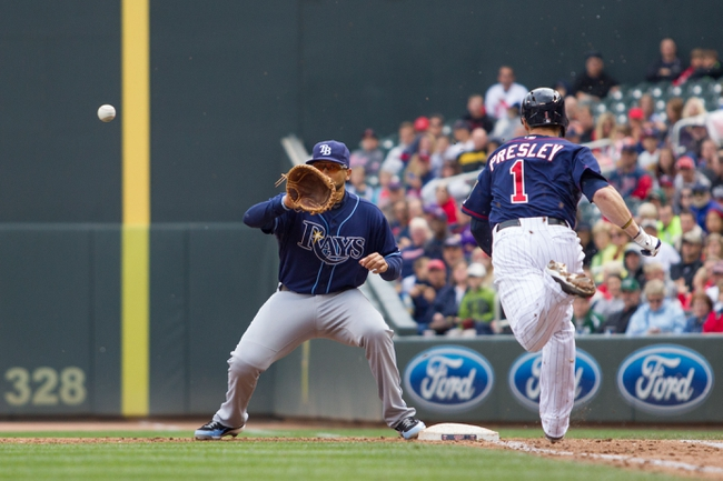 Sep 15, 2013; Minneapolis, MN, USA; The Tampa Bay Rays first baseman James Loney (21) makes the catch at first in the sixth inning against Minnesota Twins outfielder Alex Presley (1) for the out at Target Field. Mandatory Credit: Brad Rempel-USA TODAY Sports
