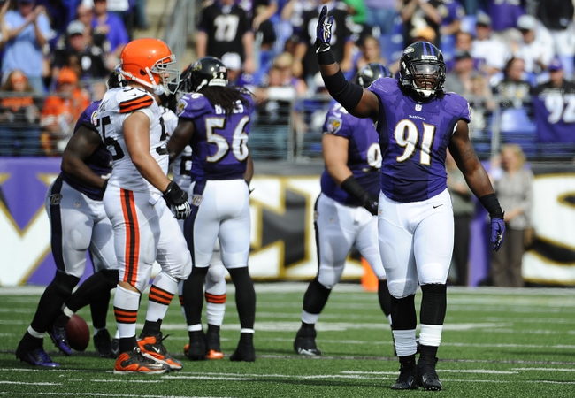 Sep 15, 2013; Baltimore, MD, USA; Baltimore Ravens linebacker Courtney Upshaw (91) celebrates after Cleveland Browns quarterback Brandon Weeden (not shown) was sacked during the second half at M&T Bank Stadium. The Ravens won 14-6. Mandatory Credit: Brad Mills-USA TODAY Sports