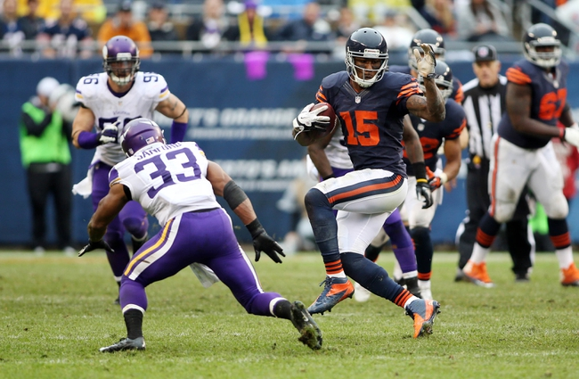 Sep 15, 2013; Chicago, IL, USA; Chicago Bears wide receiver Brandon Marshall (15) catches a pass in front of Minnesota Vikings strong safety Jamarca Sanford (33) during the third quarter at Soldier Field. The Bears won 31-30. Mandatory Credit: Jerry Lai-USA TODAY Sports