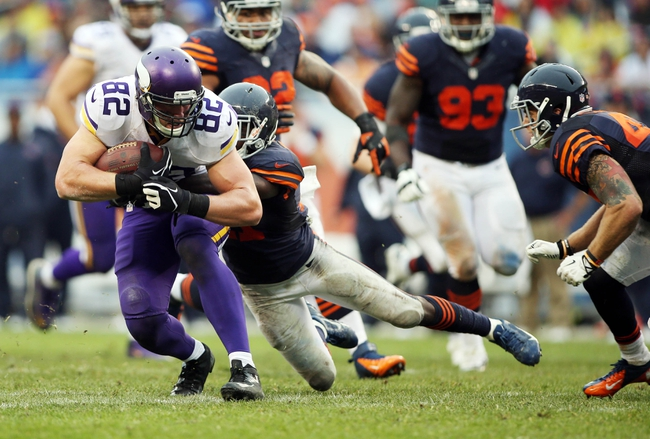Sep 15, 2013; Chicago, IL, USA; Minnesota Vikings tight end Kyle Rudolph (82) is tackled by Chicago Bears strong safety Major Wright during the fourth quarter at Soldier Field. The Bears won 31-30. Mandatory Credit: Jerry Lai-USA TODAY Sports