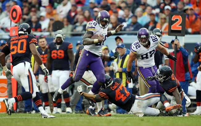 Sep 15, 2013; Chicago, IL, USA; Minnesota Vikings running back Adrian Peterson (28) leaps over Chicago Bears free safety Chris Conte (47) during the fourth quarter at Soldier Field. The Bears won 31-30. Mandatory Credit: Jerry Lai-USA TODAY Sports