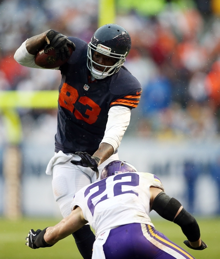 Sep 15, 2013; Chicago, IL, USA; Chicago Bears tight end Martellus Bennett (83) runs against Minnesota Vikings free safety Harrison Smith (22) during the fourth quarter at Soldier Field. The Bears won 31-30. Mandatory Credit: Jerry Lai-USA TODAY Sports