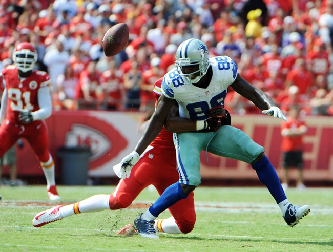 Sep 15, 2013; Kansas City, MO, USA; Dallas Cowboys wide receiver Dez Bryant (88) is unable to catch this pass while defended by Kansas City Chiefs defensive back Quintin Demps (35) in the second half at Arrowhead Stadium. Kansas City won the game 17-16. Mandatory Credit: John Rieger-USA TODAY Sports
