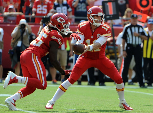 Sep 15, 2013; Kansas City, MO, USA; Kansas City Chiefs quarterback Alex Smith (11) hands off to running back Jamaal Charles (25) in the second half against the Dallas Cowboys at Arrowhead Stadium. Kansas City won the game 17-16. Mandatory Credit: John Rieger-USA TODAY Sports