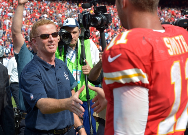 Sep 15, 2013; Kansas City, MO, USA; Dallas Cowboys head coach Jason Garrett congratulates Kansas City Chiefs quarterback Alex Smith (11) after the game at Arrowhead Stadium. The Chiefs won 17-16. Mandatory Credit: Denny Medley-USA TODAY Sports