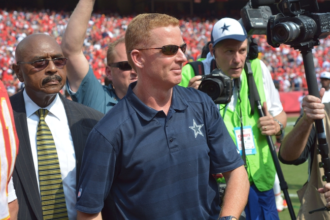 Sep 15, 2013; Kansas City, MO, USA; Dallas Cowboys head coach Jason Garrett walks to midfield after the game against the Kansas City Chiefs at Arrowhead Stadium. The Chiefs won 17-16. Mandatory Credit: Denny Medley-USA TODAY Sports
