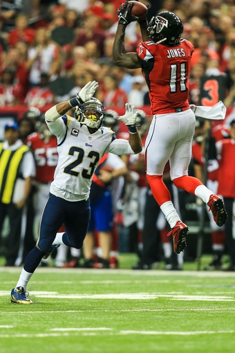 Sep 15, 2013; Atlanta, GA, USA; Atlanta Falcons wide receiver Julio Jones (11) makes a catch over St. Louis Rams safety Rodney McLeod (23) in the second half at the Georgia Dome. The Falcons won 31-24. Mandatory Credit: Daniel Shirey-USA TODAY Sports