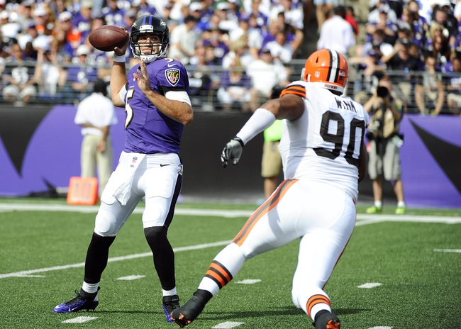 Sep 15, 2013; Baltimore, MD, USA; Baltimore Ravens quarterback Joe Flacco (5) throws a screen pass as Cleveland Browns defensive lineman Billy Winn (90) pressures during the second half at M&T Bank Stadium. The Ravens won 14 - 6. Mandatory Credit: Brad Mills-USA TODAY Sports