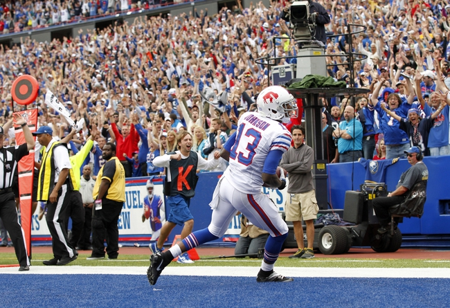 Sep 15, 2013; Orchard Park, NY, USA; Buffalo Bills wide receiver Steve Johnson (13) celebrates after catching the winning touchdown pass with seconds left from quarterback EJ Manuel (3) against the Carolina Panthers at Ralph Wilson Stadium. Mandatory Credit: Kevin Hoffman-USA TODAY Sports