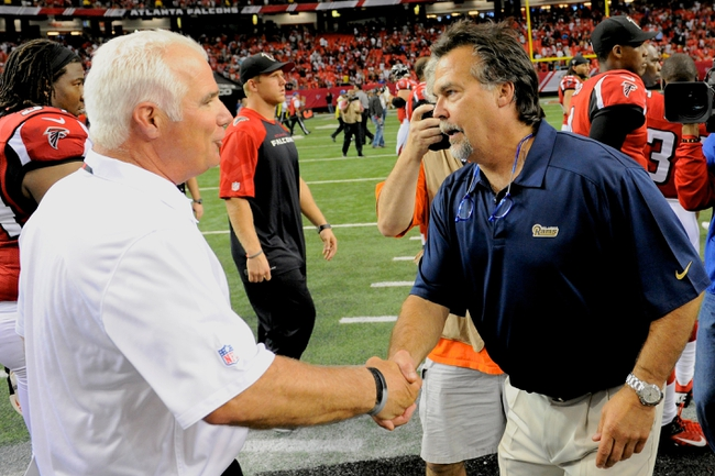 Sep 15, 2013; Atlanta, GA, USA; Atlanta Falcons head coach Mike Smith (right) shakes hands with St. Louis Rams head coach Jeff Fisher after the Falcons defeated the Rams at Georgia Dome. The Falcons defeated the Rams 31-24. Mandatory Credit: Dale Zanine-USA TODAY Sports