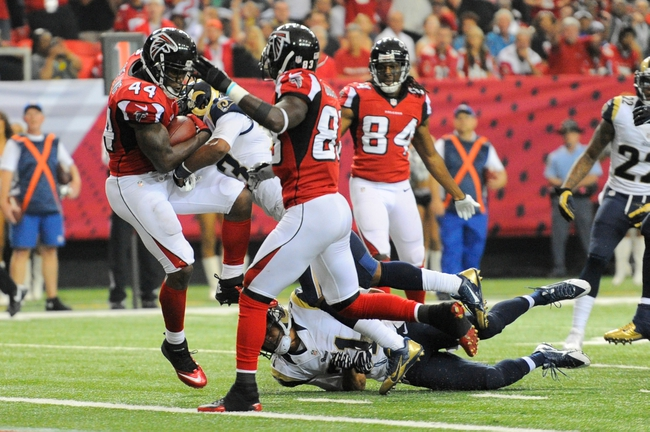 Sep 15, 2013; Atlanta, GA, USA; Atlanta Falcons fullback Jason Snelling (44) scores a touchdown past St. Louis Rams free safety Rodney McLeod (23) during the fourth quarter at Georgia Dome. The Falcons defeated the Rams 31-24. Mandatory Credit: Dale Zanine-USA TODAY Sports