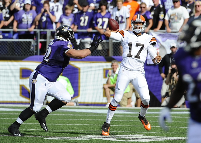 Sep 15, 2013; Baltimore, MD, USA; Cleveland Browns quarterback Jason Campbell (17) prepares to pass as Baltimore Ravens defensive tackle Haloti Ngata (92) pressures during the second half at M&T Bank Stadium. The Ravens won 14 - 6. Mandatory Credit: Brad Mills-USA TODAY Sports