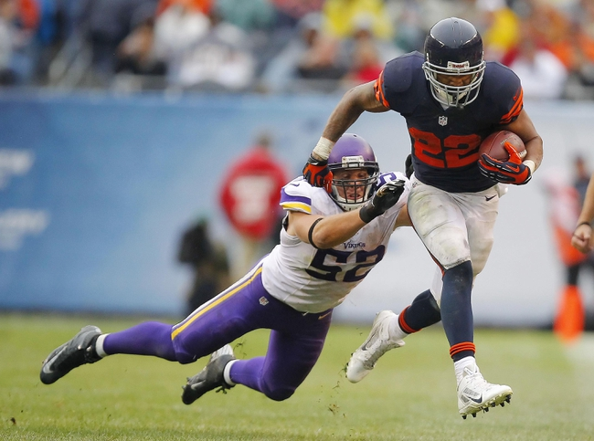 Sep 15, 2013; Chicago, IL, USA; Chicago Bears running back Matt Forte (22) runs past Minnesota Vikings outside linebacker Chad Greenway (52) during the second half at Soldier Field. Chicago won 31-30. Mandatory Credit: Dennis Wierzbicki-USA TODAY Sports