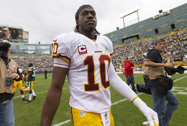 Sep 15, 2013; Green Bay, WI, USA;  Washington Redskins quarterback Robert Griffin III (10) walks off the field following the game against the Green Bay Packers at Lambeau Field.  Green Bay won 38-20.  Mandatory Credit: Jeff Hanisch-USA TODAY Sports