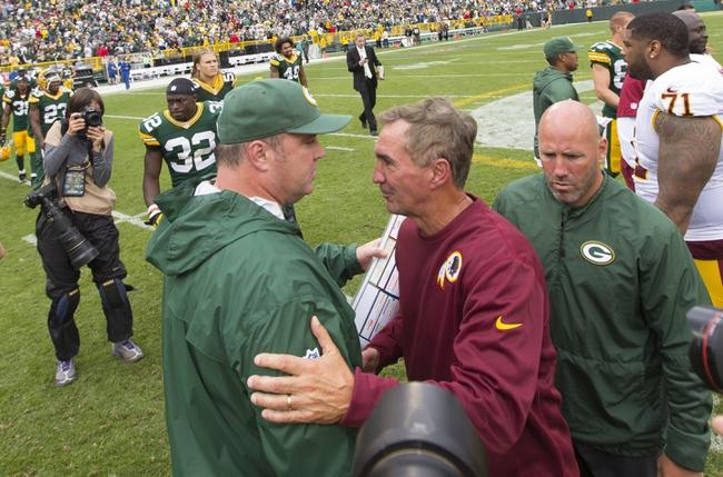 Sep 15, 2013; Green Bay, WI, USA;  Green Bay Packers head coach Mike McCarthy (left) greets Washington Redskins head coach Mike Shanahan (right) following the game at Lambeau Field.  Green Bay won 38-20.  Mandatory Credit: Jeff Hanisch-USA TODAY Sports