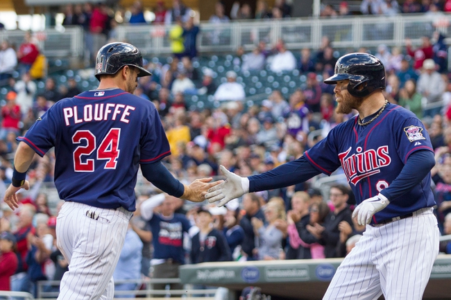 Sep 15, 2013; Minneapolis, MN, USA; The Minnesota Twins third baseman Trevor Plouffe (24) is congratulated by designated hitter Ryan Doumit (9) after scoring in the seventh inning against the Tampa Bay Rays at Target Field. Mandatory Credit: Brad Rempel-USA TODAY Sports