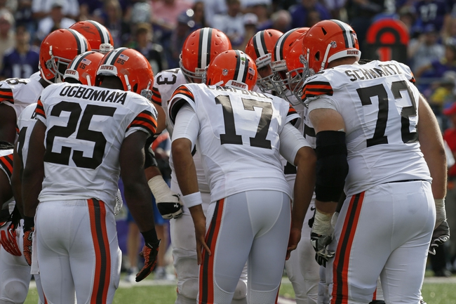 Sep 15, 2013; Baltimore, MD, USA; Cleveland Browns quarterback Jason Campbell (17) leads the offense huddle against the Baltimore Ravens defense at M&T Bank Stadium. Mandatory Credit: Mitch Stringer-USA TODAY Sports