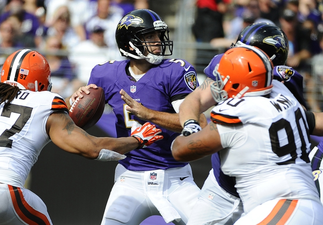 Sep 15, 2013; Baltimore, MD, USA; Baltimore Ravens quarterback Joe Flacco (5) drops back to pass against the Cleveland Browns during the second half at M&T Bank Stadium. The Ravens won 14-6. Mandatory Credit: Brad Mills-USA TODAY Sports