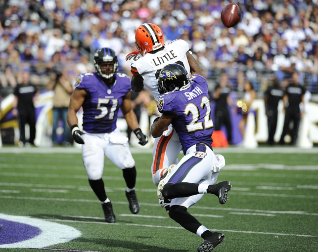Sep 15, 2013; Baltimore, MD, USA; Baltimore Ravens cornerback Jimmy Smith (22) intercepts a pass for Cleveland Browns wide receiver Greg Little (18) during the second half at M&T Bank Stadium. The Ravens won 14-6. Mandatory Credit: Brad Mills-USA TODAY Sports