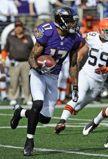Sep 15, 2013; Baltimore, MD, USA; Baltimore Ravens wide receiver Tandon Doss (17) returns a punt against the Cleveland Browns during the second half at M&T Bank Stadium. The Ravens won 14-6. Mandatory Credit: Brad Mills-USA TODAY Sports
