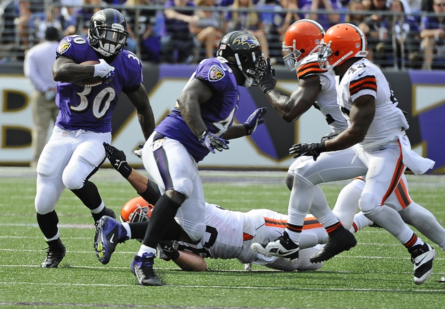 Sep 15, 2013; Baltimore, MD, USA; Baltimore Ravens running back Bernard Pierce (30) runs with the ball against the Cleveland Browns during the second half at M&T Bank Stadium. The Ravens won 14-6. Mandatory Credit: Brad Mills-USA TODAY Sports