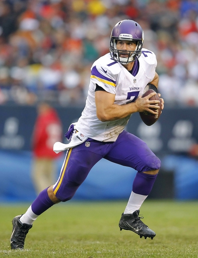 Sep 15, 2013; Chicago, IL, USA; Minnesota Vikings quarterback Christian Ponder (7) with the ball during the second half against the Chicago Bears at Soldier Field. Chicago won 31-30. Mandatory Credit: Dennis Wierzbicki-USA TODAY Sports