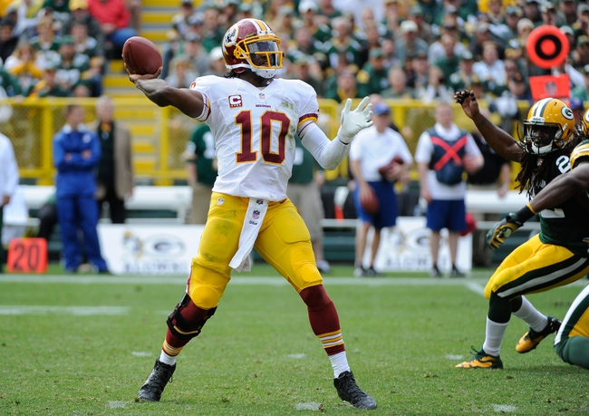 Sep 15, 2013; Green Bay, WI, USA;   Washington Redskins quarterback Robert Griffin III (10) throws a touchdown pass against the Green Bay Packers in the fourth quarter at Lambeau Field. Mandatory Credit: Benny Sieu-USA TODAY Sports