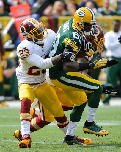 Sep 15, 2013; Green Bay, WI, USA;  Green Bay Packers wide receiver James Jones is tackled by Washington Redskins cornerback DeAngelo Hall after catching a pass in the fourth quarter at Lambeau Field. Mandatory Credit: Benny Sieu-USA TODAY Sports