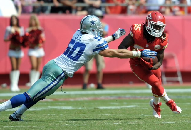 Sep 15, 2013; Kansas City, MO, USA; Kansas City Chiefs running back Jamaal Charles (25) is tackled by Dallas Cowboys middle linebacker Sean Lee (50) during the second half at Arrowhead Stadium. The Chiefs won 17-16. Mandatory Credit: Denny Medley-USA TODAY Sports