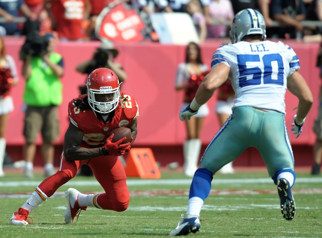 Sep 15, 2013; Kansas City, MO, USA; Kansas City Chiefs running back Jamaal Charles (25) catches a pass as Dallas Cowboys middle linebacker Sean Lee (50) defends during the second half at Arrowhead Stadium. The Chiefs won 17-16. Mandatory Credit: Denny Medley-USA TODAY Sports