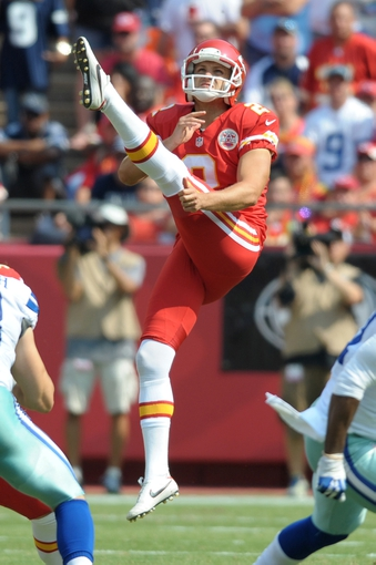 Sep 15, 2013; Kansas City, MO, USA; Kansas City Chiefs punter Dustin Colquitt (2) punts the ball during the second half of the game against the Dallas Cowboys at Arrowhead Stadium. The Chiefs won 17-16. Mandatory Credit: Denny Medley-USA TODAY Sports