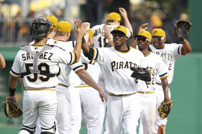 Sep 15, 2013; Pittsburgh, PA, USA; Pittsburgh Pirates catcher Tony Sanchez (59) and left fielder Starling Marte (6) celebrate with teammates after defeating the Chicago Cubs at PNC Park. The Pittsburgh Pirates won 3-2. Mandatory Credit: Charles LeClaire-USA TODAY Sports