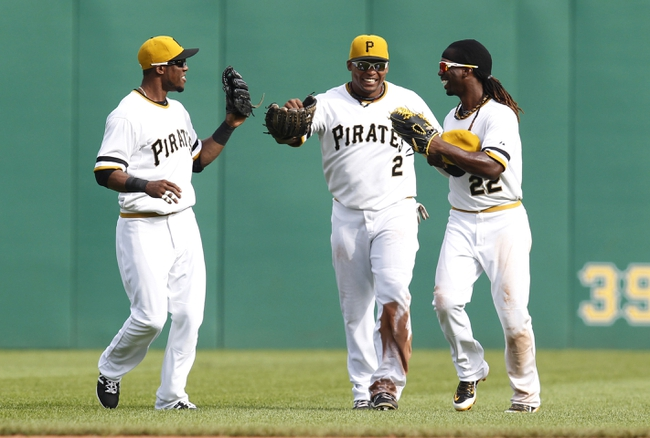 Sep 15, 2013; Pittsburgh, PA, USA; Pittsburgh Pirates left fielder Starling Marte (left) and right fielder Marlon Byrd (2) and center fielder Andrew McCutchen (22) celebrate after defeating the Chicago Cubs at PNC Park. The Pittsburgh Pirates won 3-2. Mandatory Credit: Charles LeClaire-USA TODAY Sports