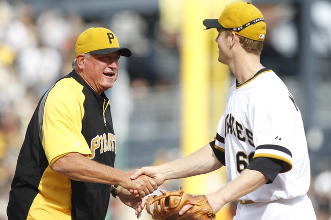 Sep 15, 2013; Pittsburgh, PA, USA; Pittsburgh Pirates manager Clint Hurdle (left) greets first baseman Justin Morneau (66) after defeating the Chicago Cubs at PNC Park. The Pittsburgh Pirates won 3-2. Mandatory Credit: Charles LeClaire-USA TODAY Sports