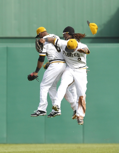 Sep 15, 2013; Pittsburgh, PA, USA; Pittsburgh Pirates left fielder Starling Marte (6) and center fielder Andrew McCutchen (rear) and right fielder Marlon Byrd (2) celebrate after defeating the Chicago Cubs at PNC Park. Mandatory Credit: Charles LeClaire-USA TODAY Sports