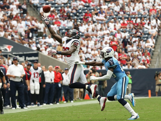 Sep 15, 2013; Houston, TX, USA; Houston Texans receiver Andre Johnson (80) jumps for the ball against Tennessee Titans cornerback Jason McCourty (30) in the fourth quarter at Reliant Stadium. Johnson did not come up with the reception on the play. The Houston Texans beat the Tennessee Titans 30-24 in overtime. Mandatory Credit: Matthew Emmons-USA TODAY Sports