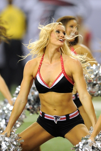 Sep 15, 2013; Atlanta, GA, USA; An Atlanta Falcons cheerleader dances during the game against the St. Louis Rams during the second half at Georgia Dome. The Falcons defeated the Rams 31-24. Mandatory Credit: Dale Zanine-USA TODAY Sports