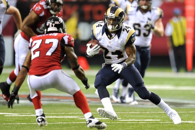 Sep 15, 2013; Atlanta, GA, USA; St. Louis Rams running back Isaiah Pead (24) runs against Atlanta Falcons cornerback Robert McClain (27) during the second half at Georgia Dome. The Falcons defeated the Rams 31-24. Mandatory Credit: Dale Zanine-USA TODAY Sports