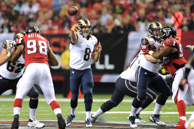 Sep 15, 2013; Atlanta, GA, USA; St. Louis Rams quarterback Sam Bradford (8) passes the ball against the Atlanta Falcons during the second half at Georgia Dome. The Falcons defeated the Rams 31-24. Mandatory Credit: Dale Zanine-USA TODAY Sports