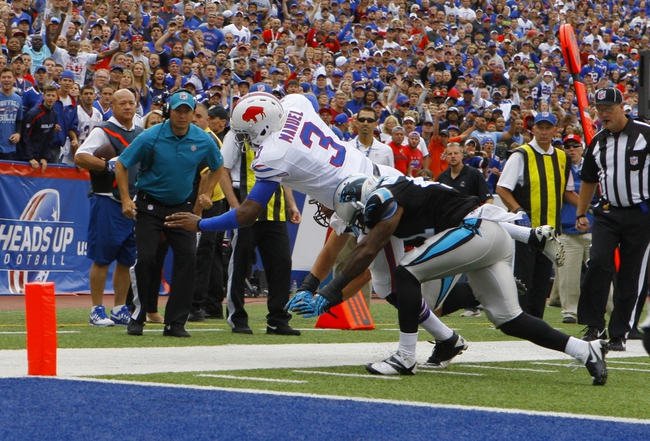 Sep 15, 2013; Orchard Park, NY, USA; Buffalo Bills quarterback EJ Manuel (3) tries to dive into the endzone during the second half against the Carolina Panthers at Ralph Wilson Stadium. Buffalo beats Carolina 27 to 26.  Mandatory Credit: Timothy T. Ludwig-USA TODAY Sports