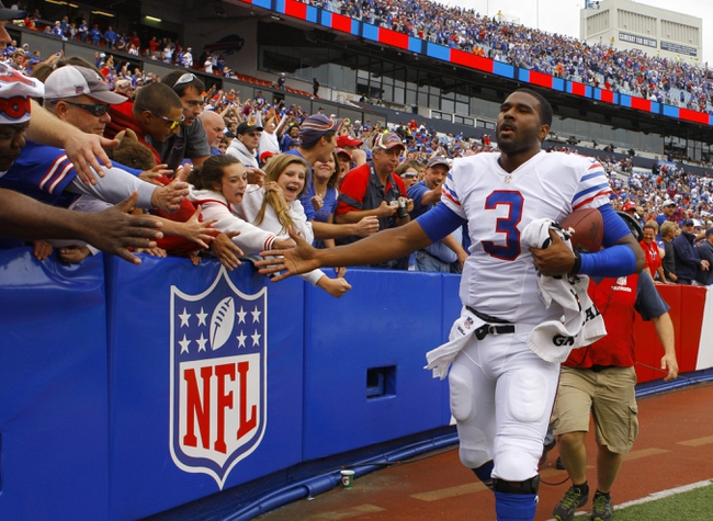 Sep 15, 2013; Orchard Park, NY, USA; Buffalo Bills quarterback EJ Manuel (3) greets fans after a victory against the Carolina Panthers at Ralph Wilson Stadium. Buffalo beats Carolina 27 to 26.  Mandatory Credit: Timothy T. Ludwig-USA TODAY Sports