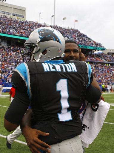 Sep 15, 2013; Orchard Park, NY, USA; Buffalo Bills quarterback EJ Manuel (3) and Carolina Panthers quarterback Cam Newton (1) shake hands after a game at Ralph Wilson Stadium. Buffalo beats Carolina 27 to 26.  Mandatory Credit: Timothy T. Ludwig-USA TODAY Sports