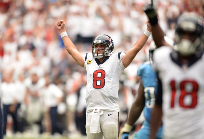 Sep 15, 2013; Houston, TX, USA; Houston Texans quarterback Matt Schaub (8) celebrates throwing the winning touchdown during overtime against the Tennessee Titans at Reliant Stadium. The Texans won 30-24. Mandatory Credit: Thomas Campbell-USA TODAY Sports