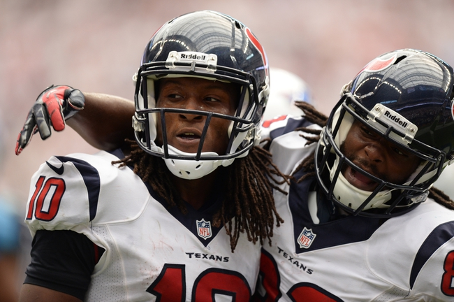 Sep 15, 2013; Houston, TX, USA; Houston Texans wide receiver DeAndre Hopkins (10) and wide receiver Keshawn Martin (82) celebrate the winning touchdown against the Tennessee Titans during overtime at Reliant Stadium. The Texans won 30-24. Mandatory Credit: Thomas Campbell-USA TODAY Sports