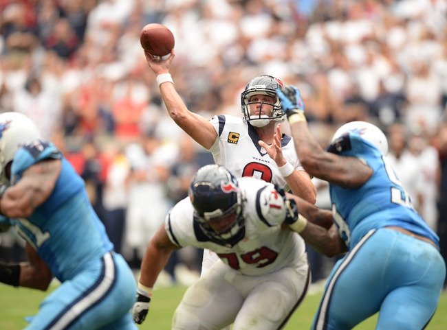 Sep 15, 2013; Houston, TX, USA; Houston Texans quarterback Matt Schaub (8) throws the winning touchdown during overtime against the Tennessee Titans at Reliant Stadium. The Texans won 30-24. Mandatory Credit: Thomas Campbell-USA TODAY Sports