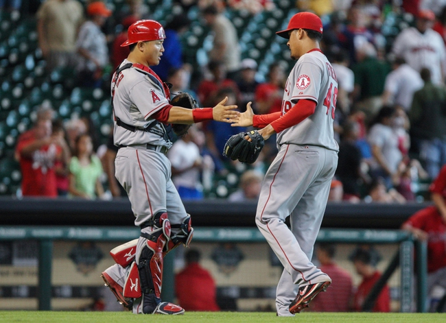 Sep 15, 2013; Houston, TX, USA; Los Angeles Angels relief pitcher Ernesto Frieri (49) and catcher Hank Conger (16) celebrate after defeating the Houston Astros 2-1at Minute Maid Park. Mandatory Credit: Troy Taormina-USA TODAY Sports