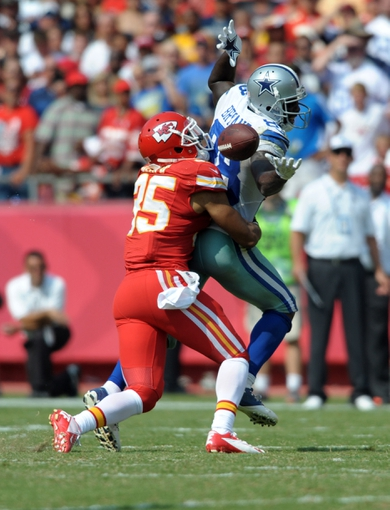 Sep 15, 2013; Kansas City, MO, USA; Kansas City Chiefs defensive back Quintin Demps (35) breaks up a pass intended for Dallas Cowboys wide receiver Dez Bryant (88) during the second half at Arrowhead Stadium. The Chiefs won 17-16. Mandatory Credit: Denny Medley-USA TODAY Sports
