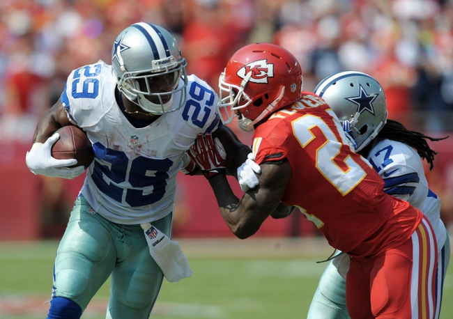 Sep 15, 2013; Kansas City, MO, USA; Dallas Cowboys running back DeMarco Murray (29) is pushed out of bounds by Kansas City Chiefs cornerback Brandon Flowers (24) during the second half of the game at Arrowhead Stadium. The Chiefs won 17-16. Mandatory Credit: Denny Medley-USA TODAY Sports